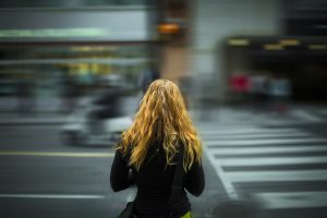 girl crossing the road
